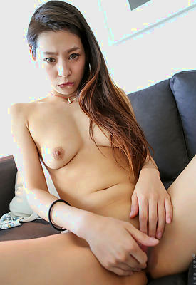 Exotic redhead Abbie is a Chinese hottie whose petite body has the right amount of T and A. Her small boobs and firm ass are a dream come true, but the best part about this hot and horny little thing is how easily she spreads her thighs and goes to work masturbating with her talented fingers.