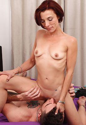 Older mature redhead amateur Stella Banks gets her pussy thrashed.