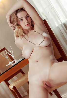 She has a pair of amazing big titties that she likes to show off from every angle.