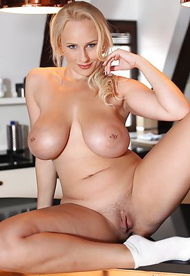 Curvy and busty babe Angel Wicky naked on the kitchen counter.