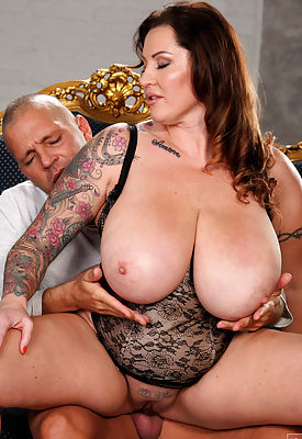Thick and busty Laura Orsolya is a stunning model and even hotter when she pops her big tits and bare pussy out to fuck