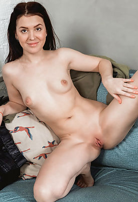 Ellie can't keep her titties inside her shirt, but with jugs like those who would want to? She's a horny little Russian with a love for sex that won't be denied. Watch her get naked and strike a series of sensual poses that leave her bald pussy dripping wet and ready to cum!